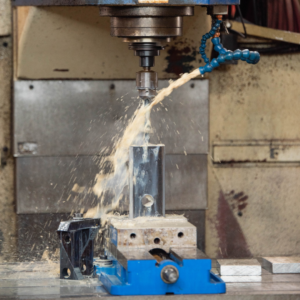 Alan uses a water jet to create parts for our clients' projects